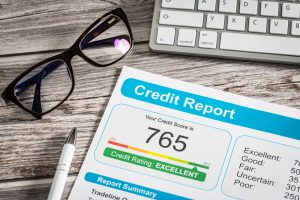 Credit report with glasses and keyboard.