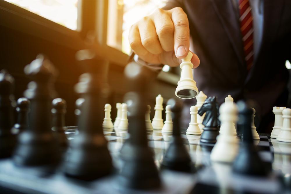 Business man playing chess.