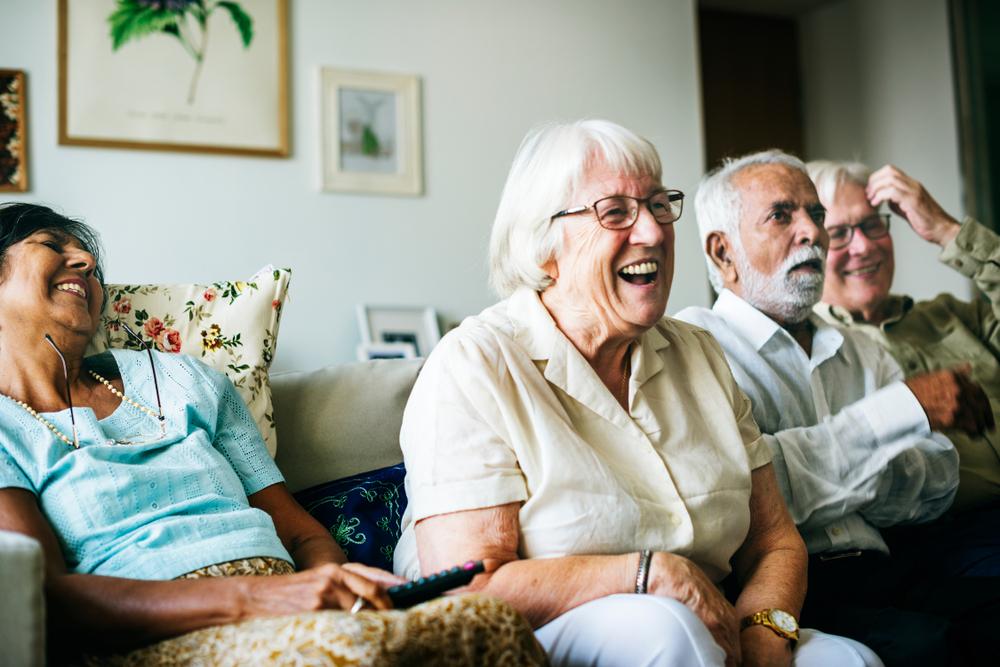 Seniors watching something together.